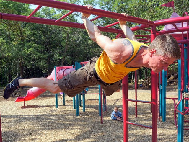 PCC Instructor Benji Williford Performs a Back Lever