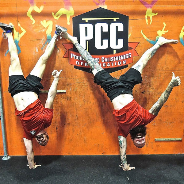 Brad and Al One-Arm Handstands