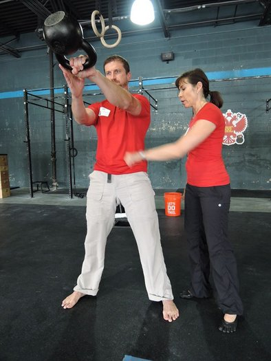 Carl Sipes and Andrea Du Cane Demonstrating Kettlebell Swings at an RKC Workshop