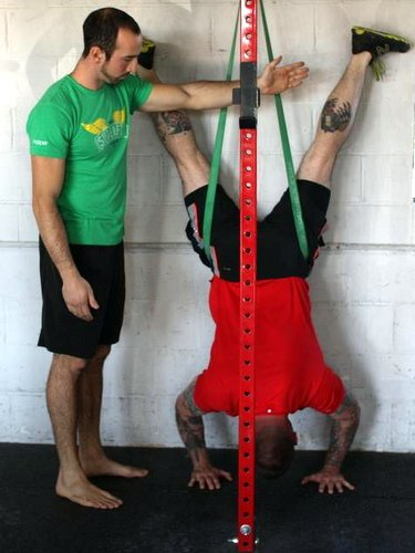 Chris Garay Training Client Assisted Handstand Push Ups