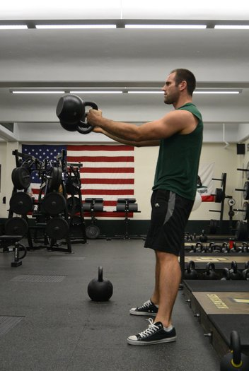 Chris Holder's training partner, Chris White swings two 32kg kettlebells