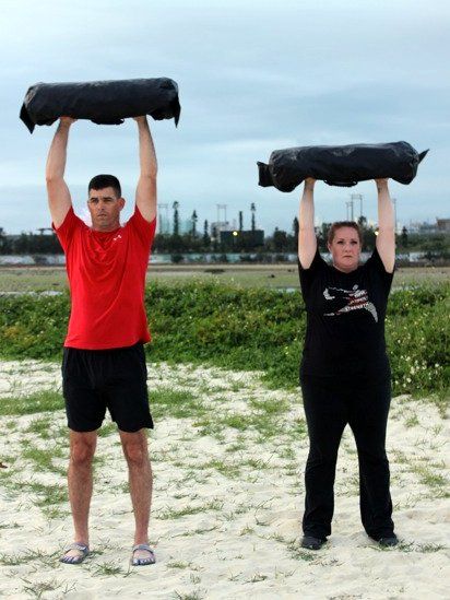 Faith and Dave Martin Ultimate Sandbag Overhead Press