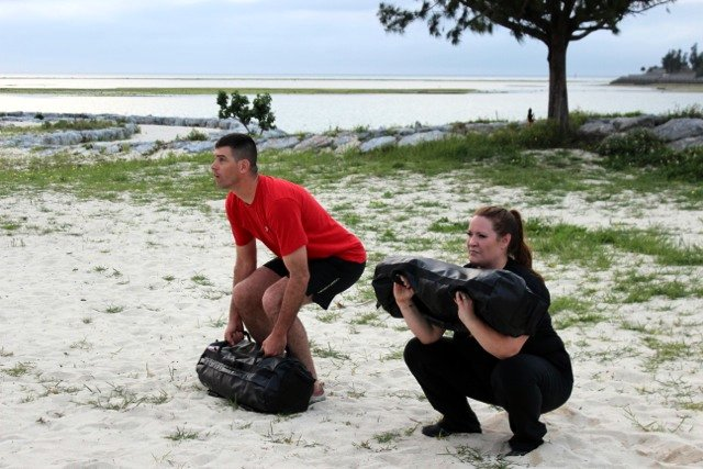 Faith and Dave Martin Ultimate Sandbag squats
