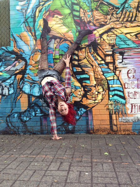 PCC Instructor, Grace Menendez one Arm Handstand