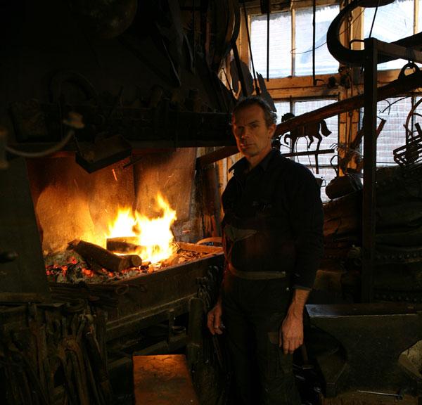 Henk van den Bergh with his forge
