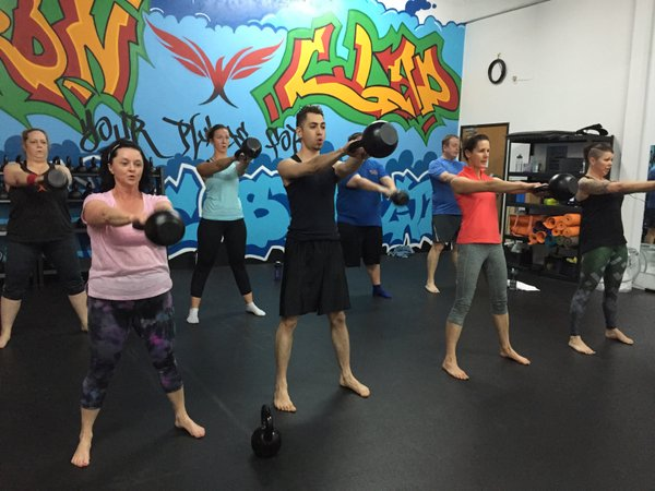 Iron Clad Fitness Group Class Kettlebell Swings