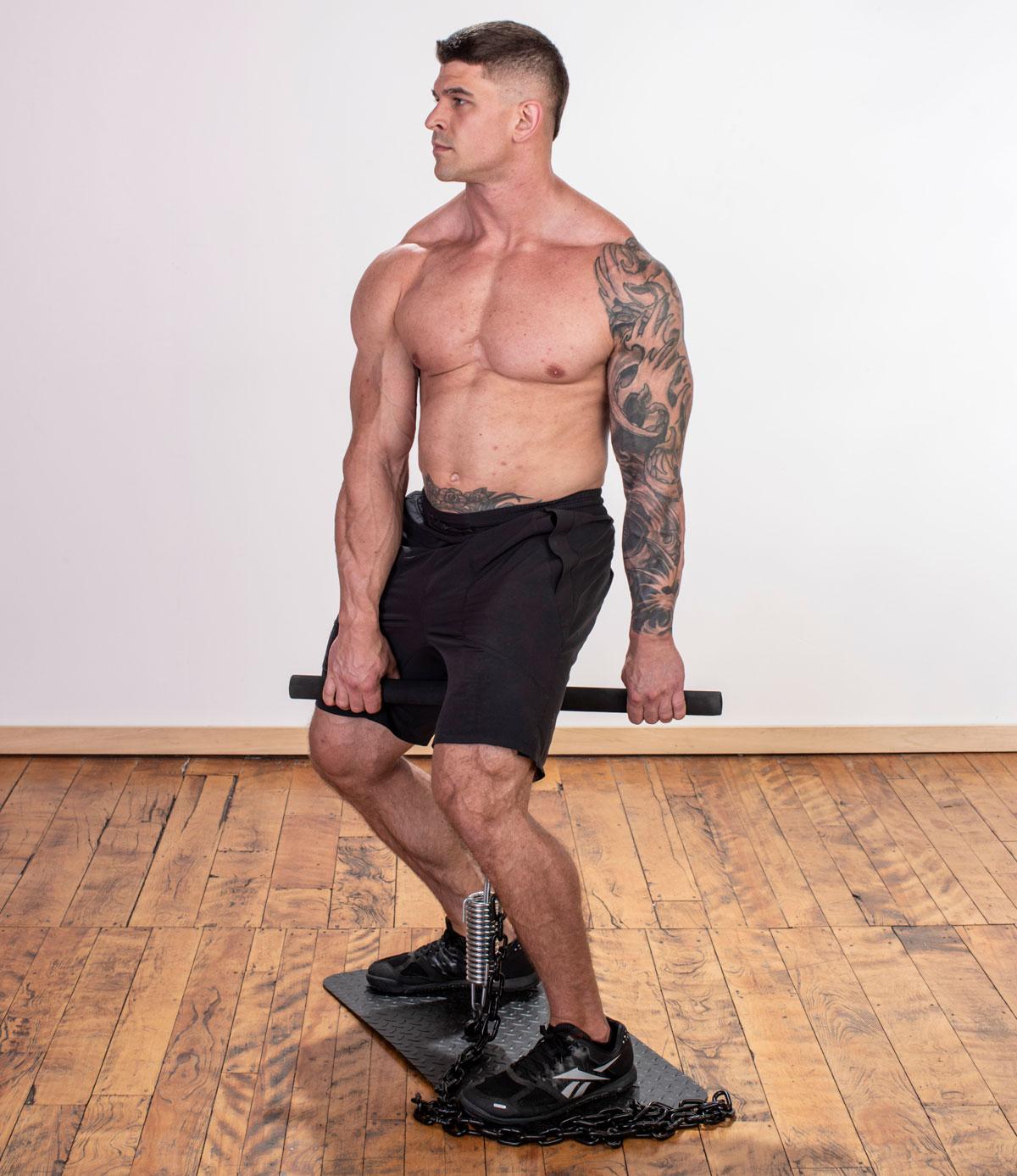 muscular male athlete performing Isochain Jefferson Deadlift