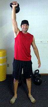 Jordan Rubin Pressing a kettlebell overhead