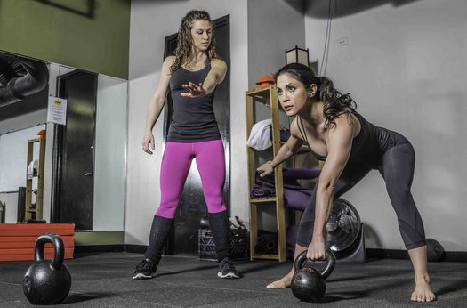 Katie Petersen instructs kettlebell swing