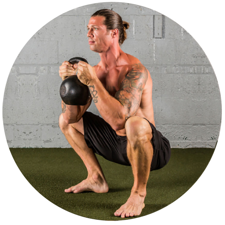 man performing goblet squat with a Dragon Door RKC Kettlebell
