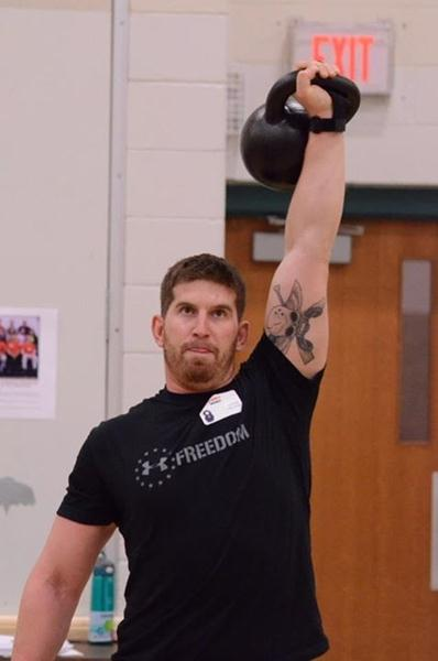 Anthony Moro Presses a Kettlebell Overhead at the RKC Workshop