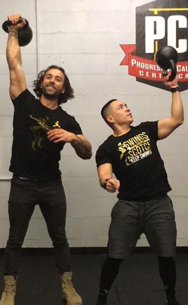 Joshua Teves and Angelo Grinceri with kettlebells