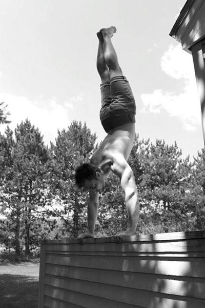 Nick Kenon Performs a Handstand