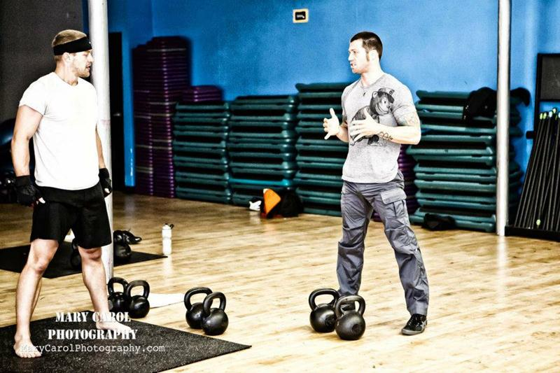 Robert Miller Training Client with Kettlebells at his gym In Kilograms