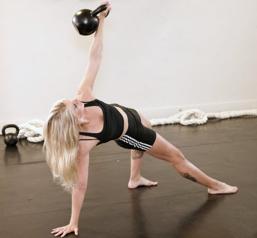Malin Kirjonen Performing a Kettlebell Get-Up