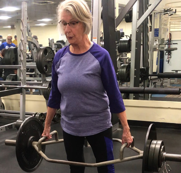 Mary's 78-year-old-client performing 100lb deadlifts for reps!