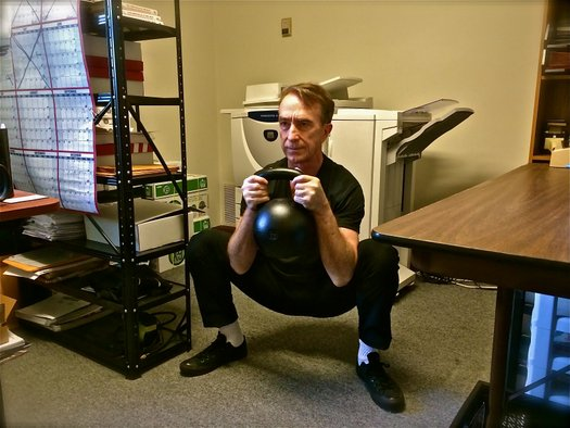 Office Workout John Du Cane performs a 30kg Goblet Squat at the Dragon Door Office