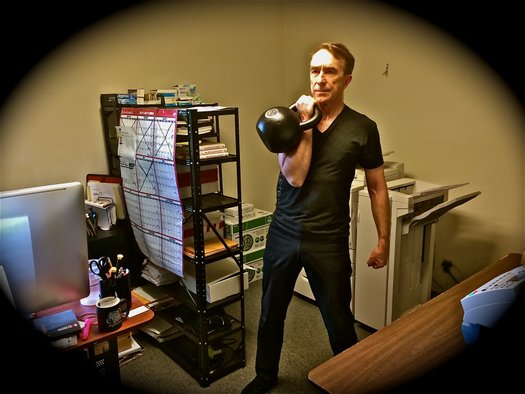 Office Workout John Du Cane performs 30kg kettlebell cleans at the Dragon Door Office