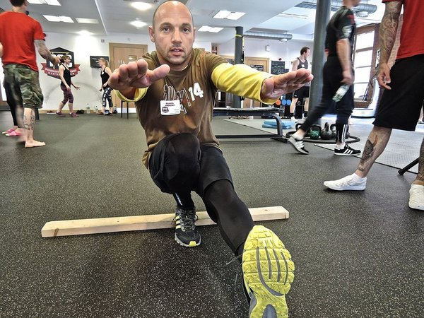 Renos Panagidis tries out a pistol squat regression at the UK PCC workshop