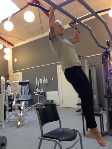 Stefan Madsen is training this active 71 year old woman with negative pull ups