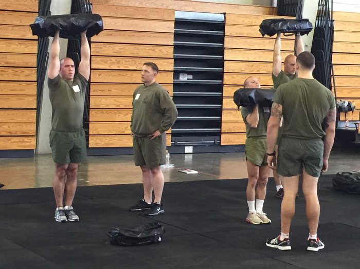 Ultimate Sandbag overhead press in military fitness training, tactical training
