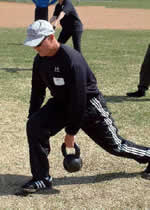 Mike Burgener, Notre Dame Football player, Champion weightlifter and head coach Junior Women's Weightlifting team practices with a Russian Kettlebell