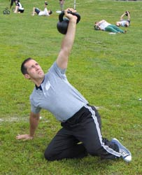 Kettlebell Success: Chiropractor Dr. Kevin Cooper demonstrates strength training exercises with Russian kettlebells