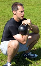 Kettlebell Success: Chiropractor Dr. Kevin Cooper demonstrates strength training routine with Russian kettlebells