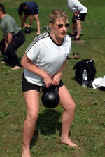 Kara Jones works out at the June 2003 Russian Kettlebell Challenge Workshop