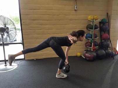 Demonstration of perfect Kettlebell single leg deadlift at Clayton Fitness Center