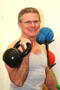 Personal Trainer in Clayton teaches Kettlebell workouts