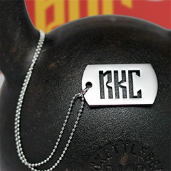 RKC Dog Tag, Standard size displayed on kettlebell